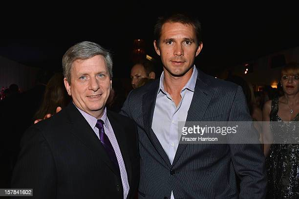Larry Boland and Jeff Hall attend the amfAR Inspiration Miami Beach Party on December 6 2012 in Miami Beach United States