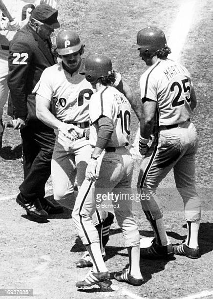 Larry Bowa and Jerry Martin of the Philadelphia Phillies congratulate teammate Mike Schmidt after Schmidt hit a home run against the New York Mets on...