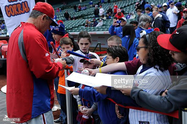 Larry Bowa of the Philadelphia Phillies signs autographs before the game against the Chicago Cubs on April 6 2014 at Wrigley Field in Chicago Illinois