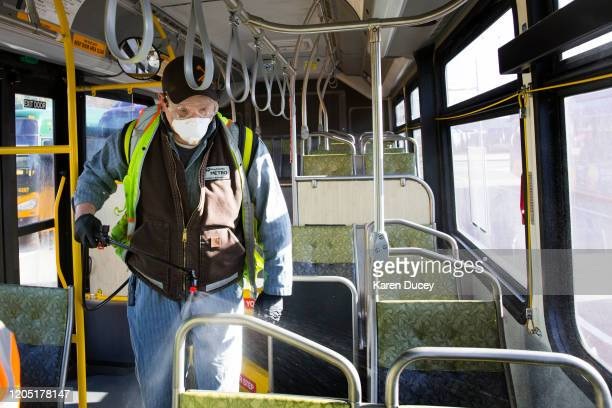 Larry Bowles an equipment service worker for King County Metro sprays Virex II 256 a disinfectant throughout a metro bus at the King County Metro...