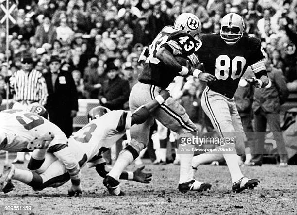 Larry Brown football player for Washington Redskins breaking a Carl Lockhart tackle football player with the Giants at the Redskins Stadium during a...