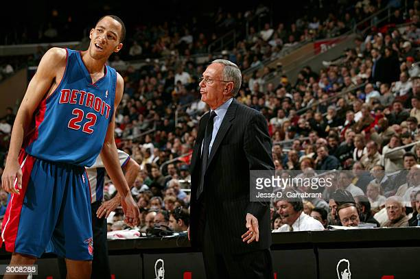 Larry Brown head coach of the Detroit Pistons gives instruction to Tayshaun Prince of the Detroit Pistons against the Philadelphia 76ers February 23...