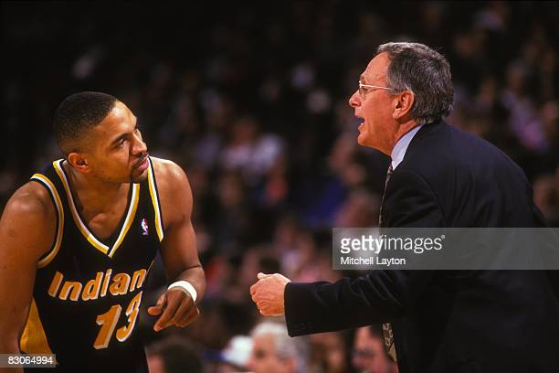 Larry Brown head coach of the Indiana Pacers and Mark Jackson talk during a NBA basketball game against the Washington Bullets at the USAir Arena on...