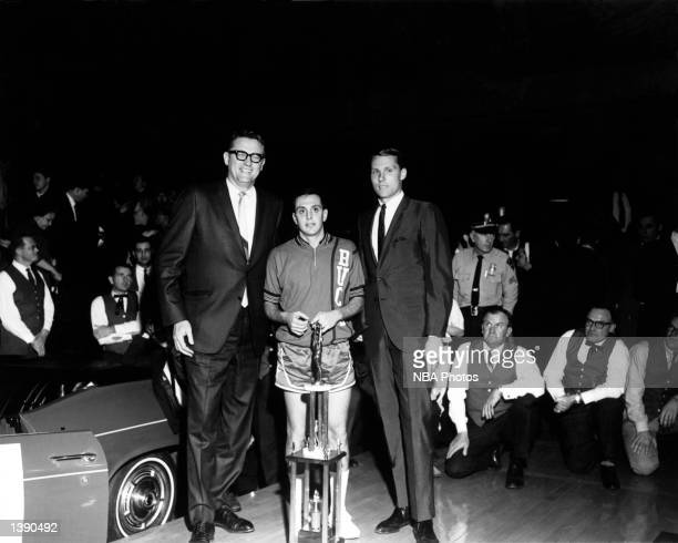 Larry Brown receives the MVP Trophy after the ABA's first All Star Game on January 9 1968 in Indianpolis IN George Mikan the first ABA Commissiioner...