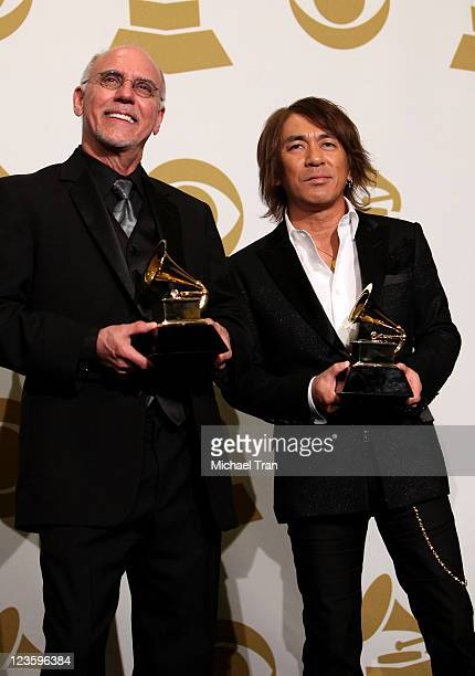 Larry Carlton and Tak Matsumoto, winners of the Best Pop Instrumental Album award for 'Take Your Pick' pose in the press room at The 53rd Annual...
