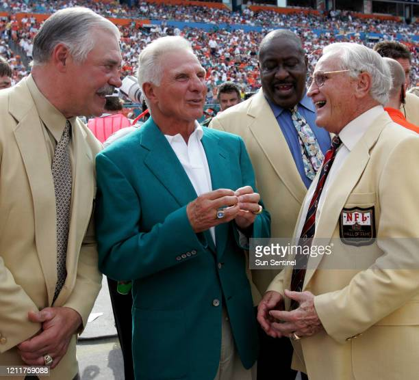 Larry Csonka left Nick Buoniconti Larry Little and former coach Don Shula share a laugh before half time ceremonies honoring Dan Marino at Dolphins...