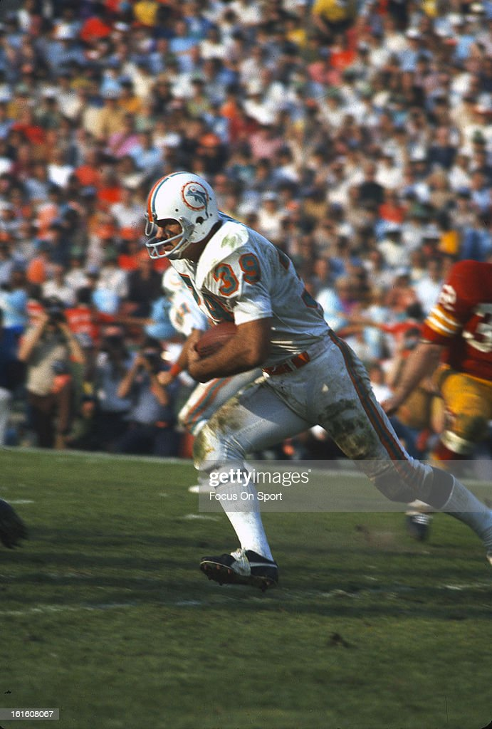 Larry Csonka #39 of the Miami Dolphins carries the ball against the Washington Redskins during Super Bowl VII at the Los Angeles Memorial Coliseum in Los Angeles, California, January 14, 1973. The Dolphins won the Super Bowl 14-7.