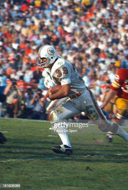 Larry Csonka of the Miami Dolphins carries the ball against the Washington Redskins during Super Bowl VII at the Los Angeles Memorial Coliseum in Los...