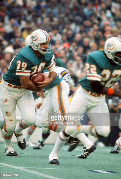Larry Csonka of the Miami Dolphins carries the ball against the Minnesota Vikings during Super Bowl VIII at Rice Stadium January 13 1974 in Houston...