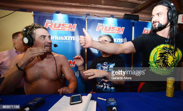 Larry Dallas and Wrestler Drew Galloway greet during SiriusXM's Busted Open Live From WrestleMania 33on April 1 2017 in Orlando City