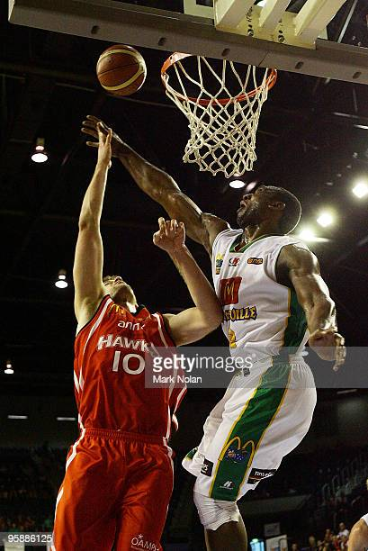 Larry Davidson of the Hawks has his shot blocked by Rolan Roberts of Townsville during the round 17 NBL match between the Wollongong Hawks and the...