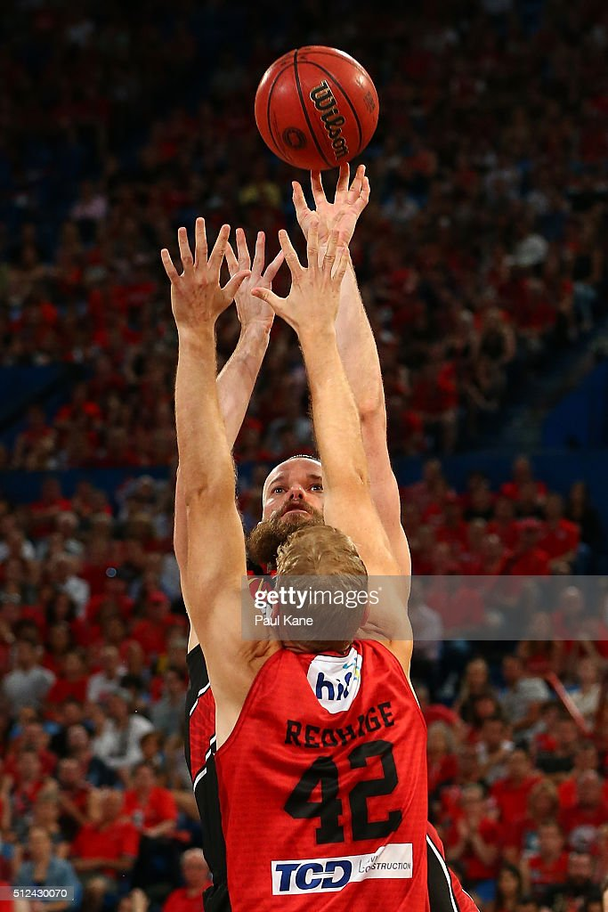 Larry Davidson of the Hawks puts a shot up against Shawn Redhage of the Wildcats during the NBL Semi Final match between Perth Wildcats and Illawarra Hawks at Perth Arena on February 26, 2016 in Perth, Australia.