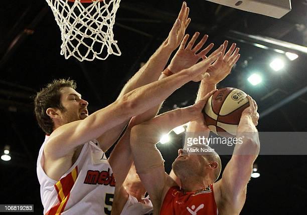 Larry Davidson of the Hawks under pressure from the defence of Tommy Greer of the Tigers during the round five NBL match between the Wollongong Hawks...