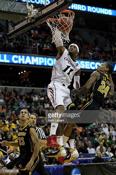 Larry Davis of the Cincinnati Bearcats dunks over Kim English of the Missouri Tigers during the second round of the 2011 NCAA men's basketball...