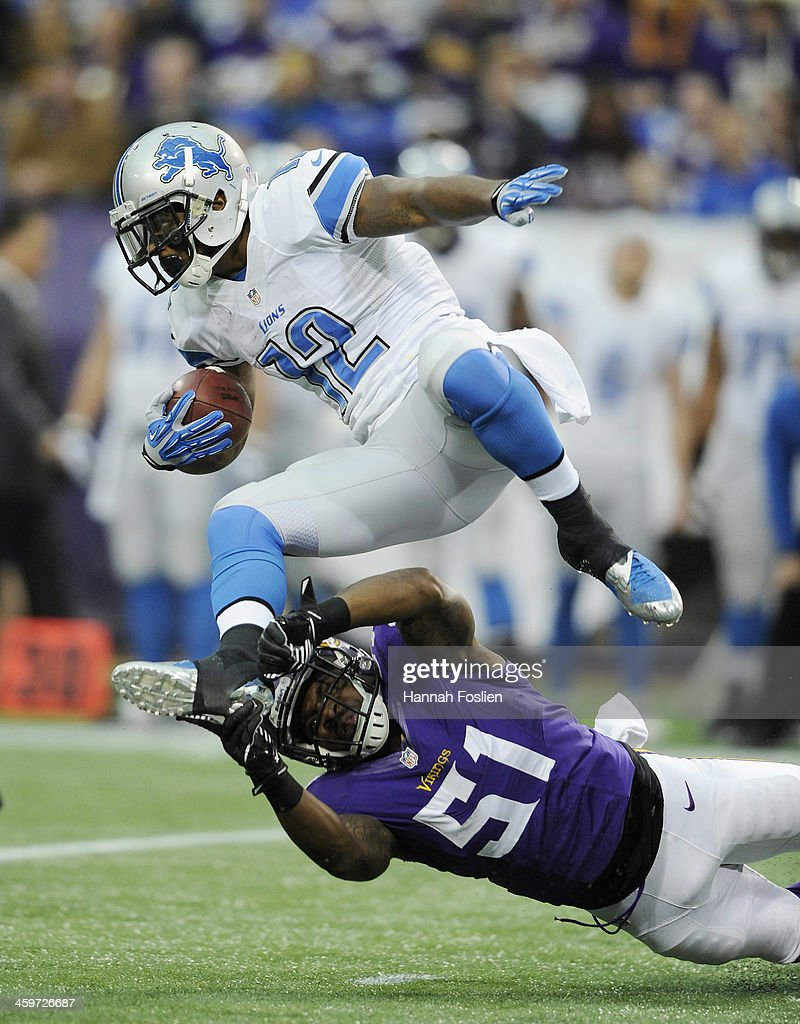 Larry Dean #51 of the Minnesota Vikings tackles Jeremy Ross #12 of the Detroit Lions during the first quarter of the game on December 29, 2013 at Mall of America Field at the Hubert H. Humphrey Metrodome in Minneapolis, Minnesota.