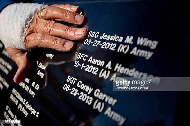 Larry Dearborn of Richmond moves his hand over the lettering of the window in his 1997 Lincoln Town Car Limousine that he and his wife Rita drive...