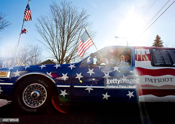 Larry Dearborn poses for a portrait with his 1997 Lincoln Town Car Limo that he drives around the state with his wife Rita to honor veterans of...