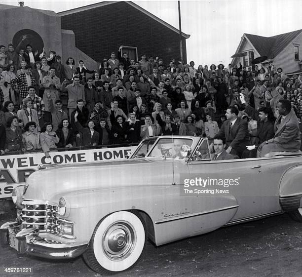 Larry Doby and his wife Helyn wave to cheering Eastside High School students who were given half a day off from school studies to help celebrate...