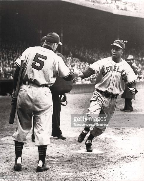 BOSTON MAY 10 1948 Larry Doby has just homered and Cleveland Indians manager and shortstop Lou Boudreau welcomes him home during a game at Fenway...
