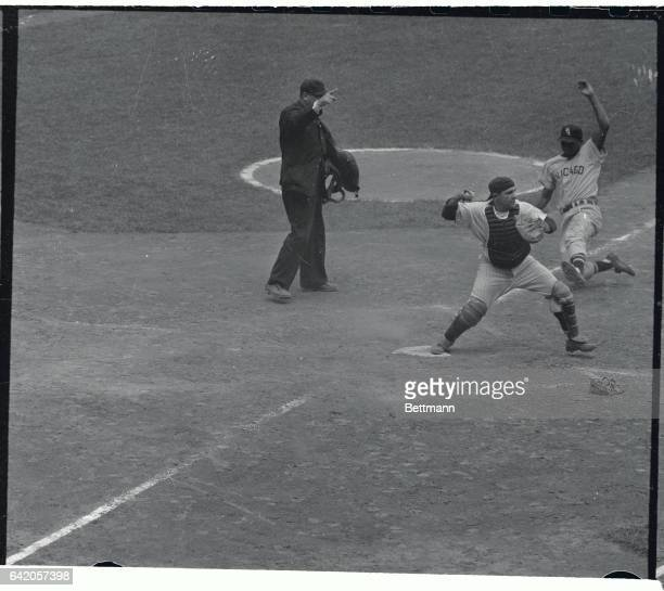 Larry Doby of the Chicago White Sox is shown as he tried to break up a double play while being forced at home in the third inning of today's game...