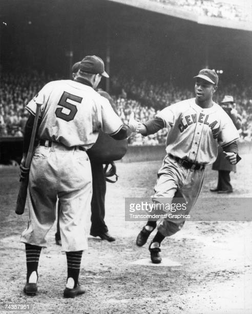 BOSTON MAY 10 1948 Larry Doby outfielder for the Cleveland Indians is congratulated by teammate and manager Lou Boudreau at Fenway Park's home plate...
