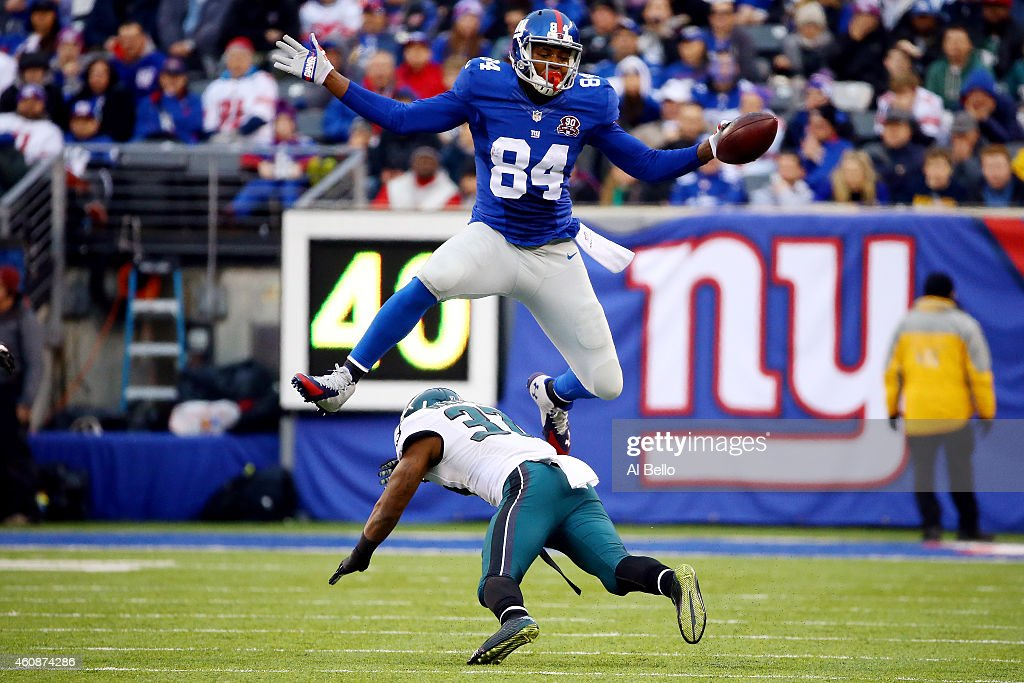Larry Donnell #84 of the New York Giants jumps over Jaylen Watkins #37 of the Philadelphia Eagles in the third quarter during a game at MetLife Stadium on December 28, 2014 in East Rutherford, New Jersey.