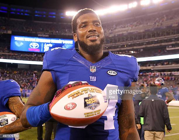 Larry Donnell of the New York Giants poses with the Sunday Night Football Player of the game ball after the win over the San Francisco 49ers at...