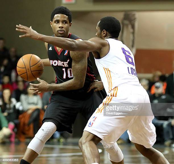 Larry Drew II from the Sioux Falls Skyforce looks for help around the defense of Kalin Lucas from the Iowa Energy in the first half of their NBA...