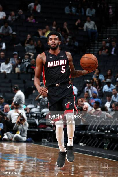 Larry Drew II of the Miami Heat handles the ball during the game against the Brooklyn Nets during a preseason game on October 5 2017 at Barclays...