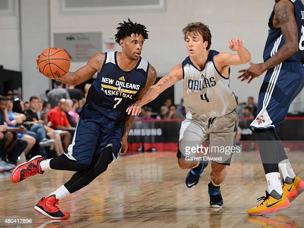 Larry Drew II of the New Orleans Pelicans drives to the basket against Kevin Pangos of the Dallas Mavericks on July 11 2015 at the Cox Pavilion in...