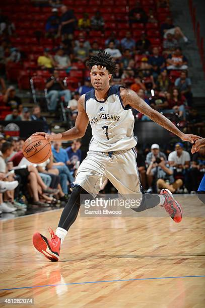 Larry Drew II of the New Orleans Pelicans handles the ball against the Golden State Warriors during the 2015 NBA Las Vegas Summer League game on July...