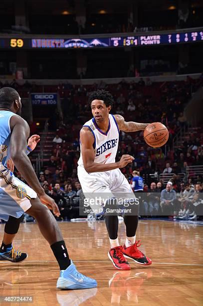 Larry Drew II of the Philadelphia 76ers looks to pass the ball against the Denver Nuggets at Wells Fargo Center on February 3 2015 in Philadelphia...