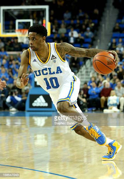 Larry Drew II of the UCLA Bruins drives against the Long Beach State 49ers at Pauley Pavilion on December 18 2012 in Los Angeles California UCLA won...