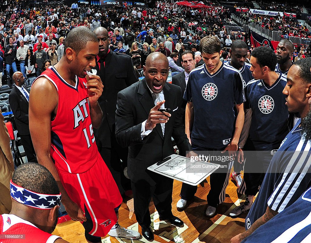 Larry Drew of the Atlanta Hawks talks with his team during the game against the Miami Heat at Philips Arena on November 9, 2012 in Atlanta, Georgia.