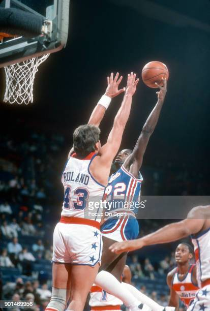 Larry Drew of the Kansas City Kings shoots over Jeff Ruland of the Washington Bullets during an NBA basketball game circa 1984 at The Capital Centre...