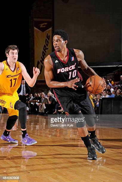 Larry Drew of the Sioux Falls Skyforce drives to the hoop against Sergey Karasev of the Canton Charge at the Canton Memorial Civic Center on April 10...