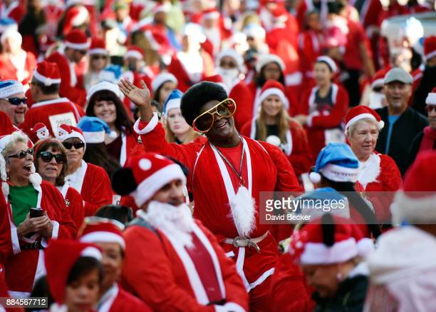 Larry Edwards of Nevada dressed in Santa Claus costume participates in the 13th annual Las Vegas Great Santa Run benefiting Opportunity Village at...
