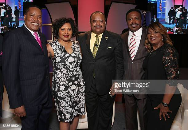 Larry Elder Moderator Tara Wall Roland Martin Bishop Kenneth Ulmer and Togetta Ulmer attend the Inform Your Vote President Election Debate at The...