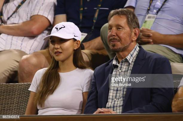 Larry Elison watches Vasek Pospisil of Canada against Andy Murray of Great Britain in their second round match during day six of the BNP Paribas Open...