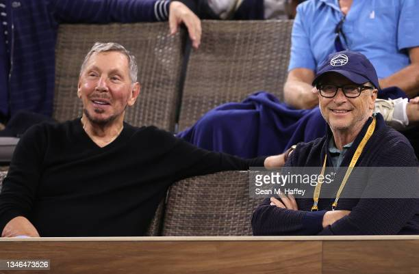 Larry Ellison and Bill Gates watch a match between Gael Monfils of France and Alexander Zverev of Germany on Day 10 of the BNP Paribas Open at the...