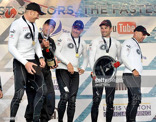 Larry Ellison and the crew of Oracle Racing celebrate their first place win of the America's Cup San Diego Match Racing Championship with a...