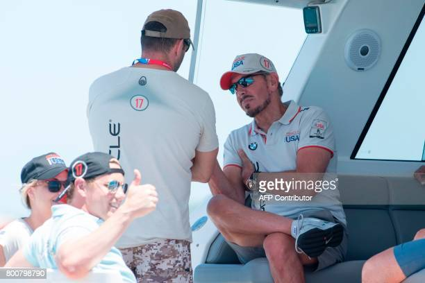 Larry Ellison executive chairman and chief technology officer of Oracle talks to someone before Oracle Team USA raced against Emirates Team New...