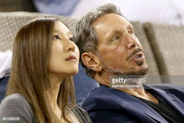Larry Ellison watches Damir Dzumhur of Bosnia and Herzegovina plays Ryan Harrison during the BNP Paribas Open at the Indian Wells Tennis Garden on...