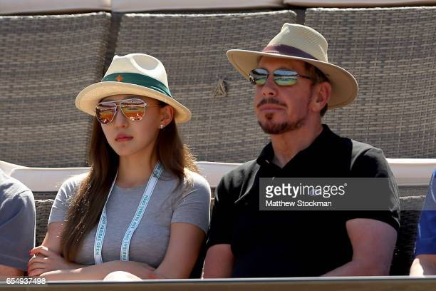 Larry Ellison watches Stan Wawrinka of Switzerland play Pablo Carreno Busta of Spain during the semifinals of the BNP Paribas Open at the Indian...