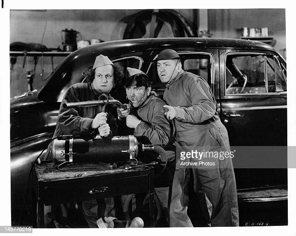Larry Fine Moe Howard and Curly Howard as the Three Stooges in a scene from uknown film Circa 1940