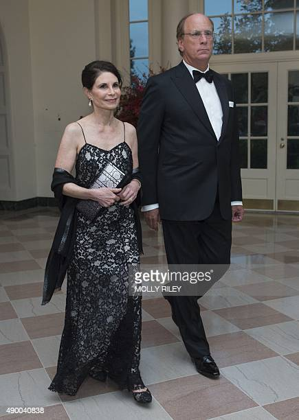 Larry Fink Chairman and CEO BlackRock and Lori Fink arrive for the State Dinner for President Xi of China at the White House on September 25 2015 in...