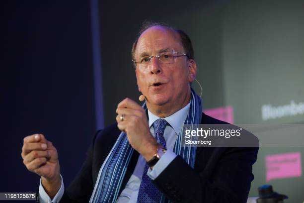 Larry Fink chief executive officer of BlackRock Inc gestures as he speaks during a Bloomberg event on the opening day of the World Economic Forum in...