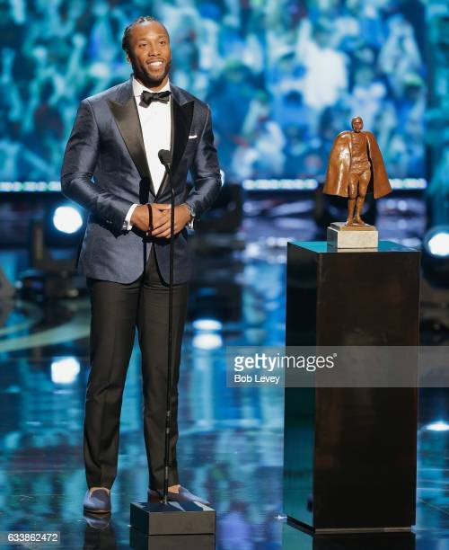 Larry Fitzgerald accepts the Walter Payton NFL Man of the Year presented by Nationwide at Wortham Theater Center on February 4 2017 in Houston Texas...