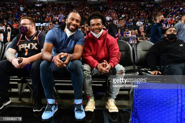 Larry Fitzgerald Jr. And Kyler Murray of the Arizona Cardinals look on during Round 2, Game 2 of the 2021 NBA Playoffs between the Denver Nuggets and...