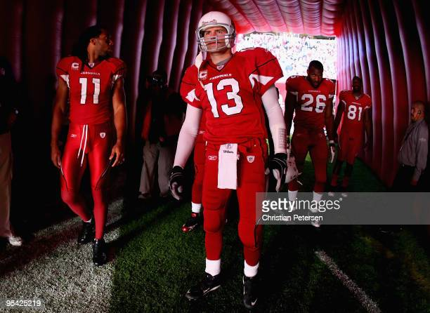 Larry Fitzgerald, Kurt Warner, Beanie Wells and Anquan Boldin of the Arizona Cardinals prepare to take the field before the NFL game against the St....